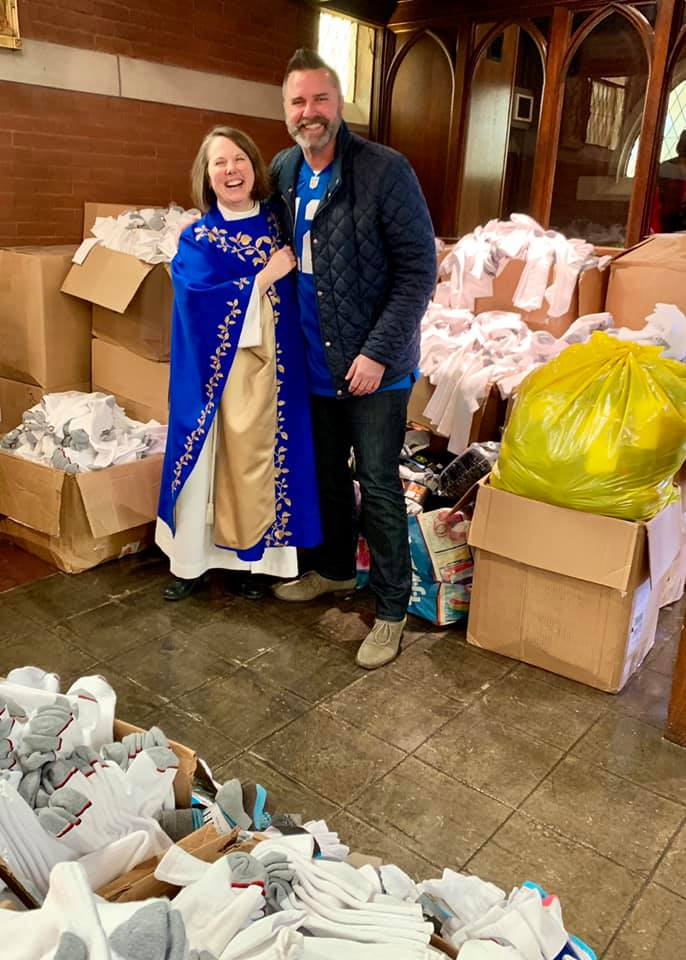 Wille and Tomlinson with socks collected during Advent